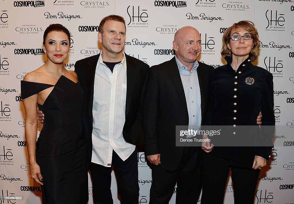 Eva Longoria, Tilman Fertitta, Mark Kelly and Gabrielle Giffords arrive at the grand opening of SHe by Morton's at Crystals at CityCenter on February 2, 2013 in Las Vegas, Nevada.