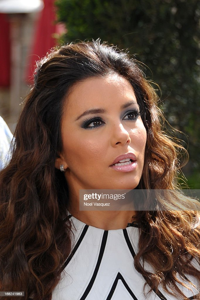 <a gi-track='captionPersonalityLinkClicked' href=/galleries/search?phrase=Eva+Longoria&family=editorial&specificpeople=202082 ng-click='$event.stopPropagation()'>Eva Longoria</a> visits 'Extra' at The Grove on May 7, 2013 in Los Angeles, California.