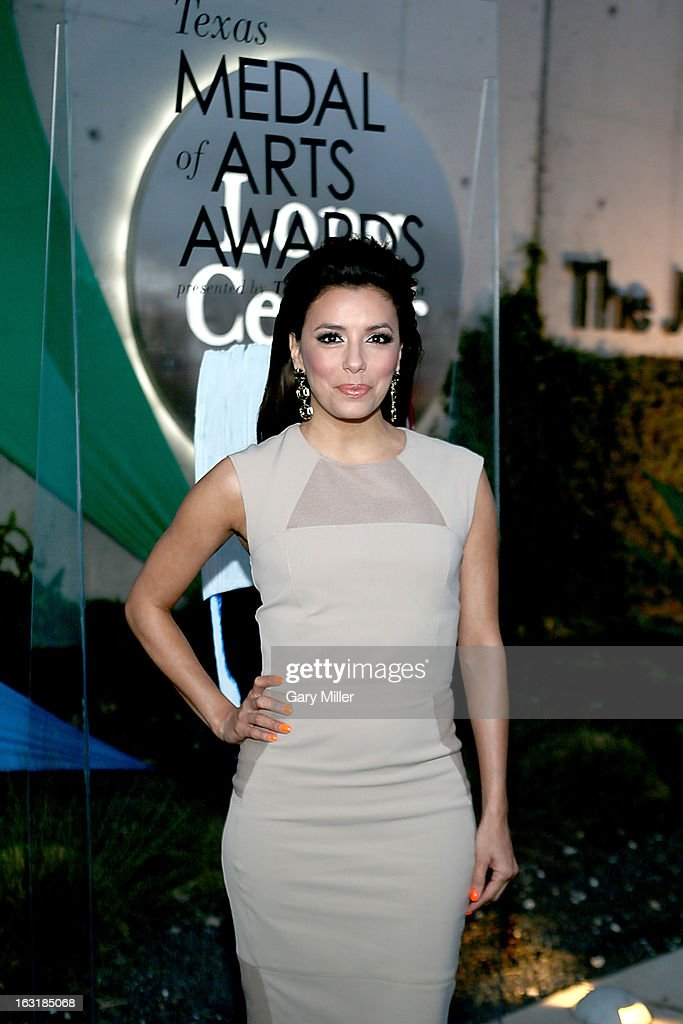 <a gi-track='captionPersonalityLinkClicked' href=/galleries/search?phrase=Eva+Longoria&family=editorial&specificpeople=202082 ng-click='$event.stopPropagation()'>Eva Longoria</a> walks the red carpet before the Texas Medal of Arts Awards show at The Long Center on March 5, 2013 in Austin, Texas.