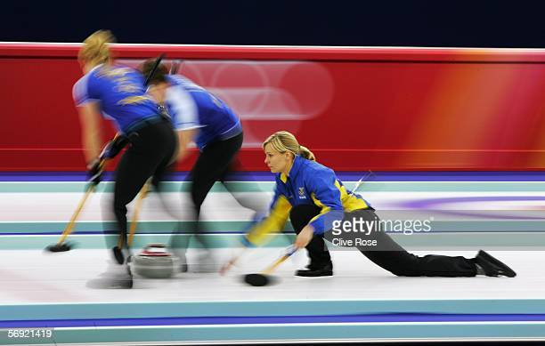 Eva Lund of Sweden releases a stone during the gold medal match of the women's curling between Sweden and Switzerland during Day 13 of the Turin 2006...