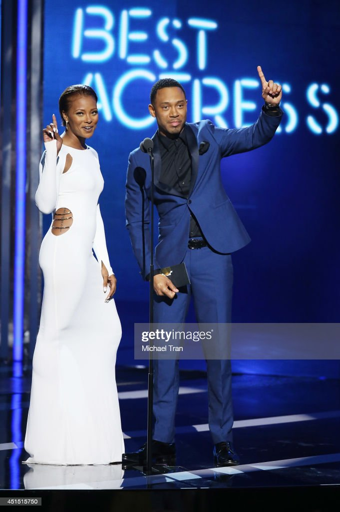 Eva Marcille (L) and Terrence Jenkins speak onstage during the 'BET AWARDS' 14 held at Nokia Theater L.A. LIVE on June 29, 2014 in Los Angeles, California.