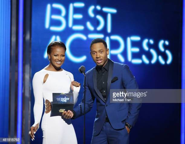 Eva Marcille and Terrence Jenkins speak onstage during the 'BET AWARDS' 14 held at Nokia Theater LA LIVE on June 29 2014 in Los Angeles California