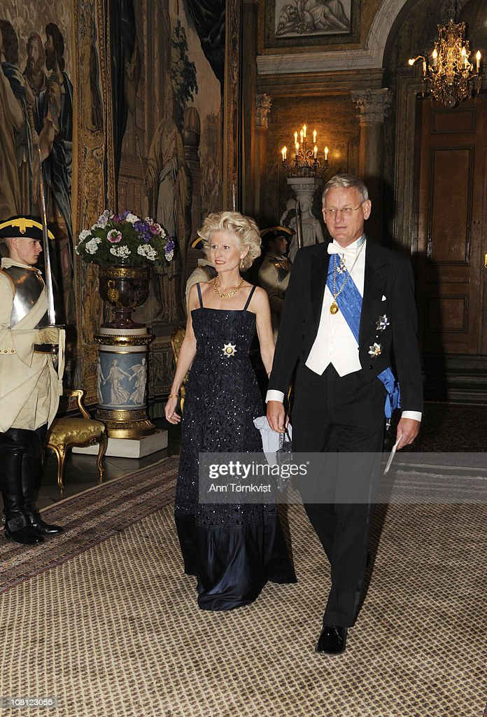 Eva Maria Corazza Bildt and her husband Swedish Foreign Minister <a gi-track='captionPersonalityLinkClicked' href=/galleries/search?phrase=Carl+Bildt&family=editorial&specificpeople=3972090 ng-click='$event.stopPropagation()'>Carl Bildt</a> arrive at a banquet hosted by the Royal Family at the palace on the first day of the Estonian state visit on January 18, 2011 in Stockholm, Sweden.