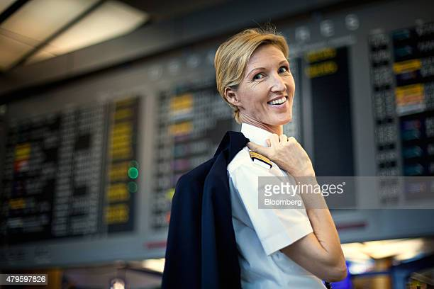Eva Maria Thien a pilot at Scoot Pte a unit of Singapore Airlines Ltd poses for a photograph at Changi Airport Terminal 2 in Singapore on Wednesday...