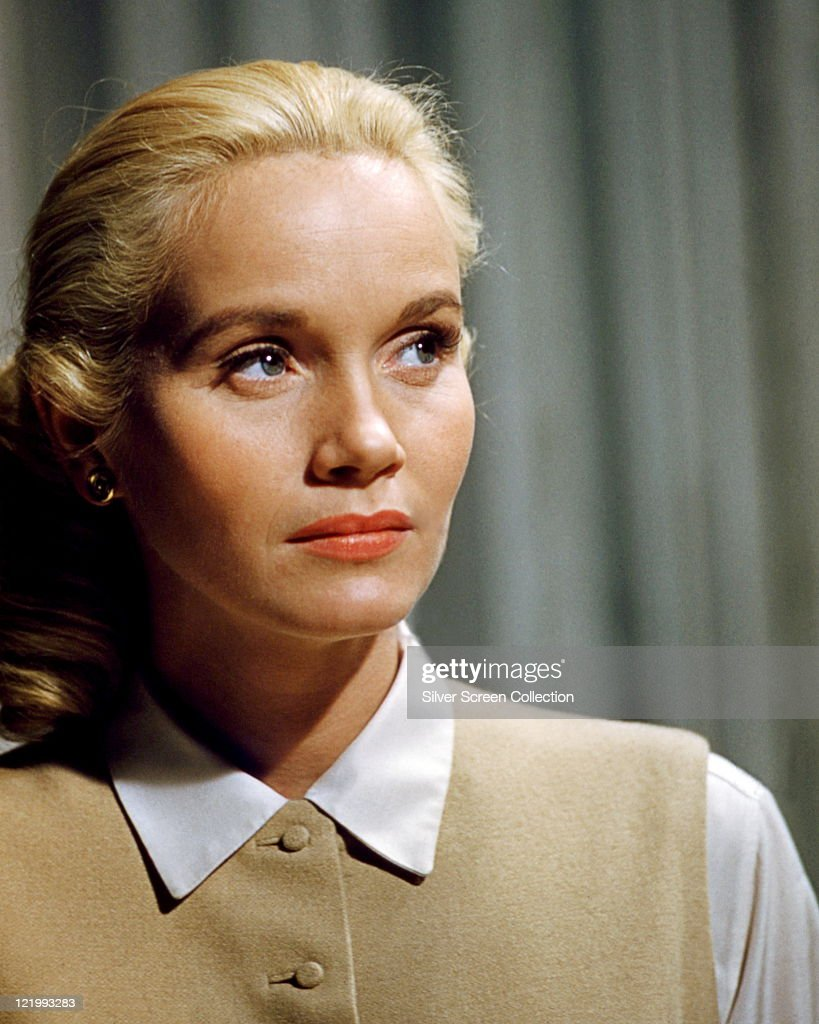 Eva Marie Saint, US actress, wearing a white blouse and a beige waistcoat, with a nervous expression on her face, circa 1955.