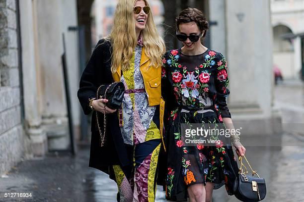 Eva McMahon wearing River Island set with prints Dior sunglasses Armani exchange coat Zara jacket Chanel bag and Barbora Ondrackova wearing a black...