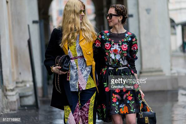 Eva McMahon wearing River Island set with prints Dior sunglasses Armani exchange coat Zara jacket Chanel bag and Barbora Ondrackova wearing a black...