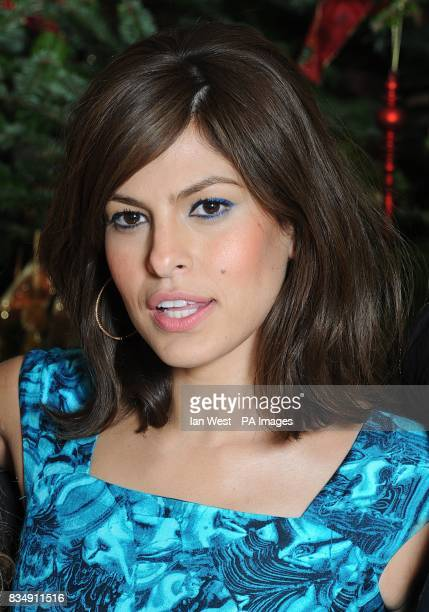 Eva Mendes attends a photocall to promote Frank Miller's latest film 'The Spirit' at the Mandarin Oriental in central London