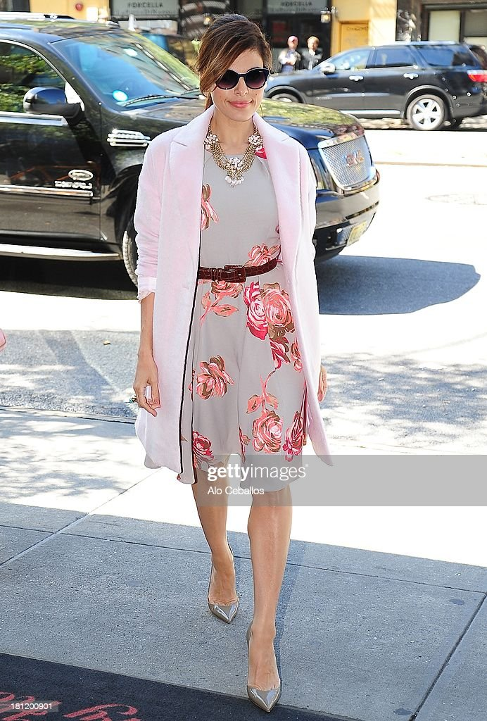 <a gi-track='captionPersonalityLinkClicked' href=/galleries/search?phrase=Eva+Mendes&family=editorial&specificpeople=194937 ng-click='$event.stopPropagation()'>Eva Mendes</a> is seen arriving at her hotel on September 19, 2013 in New York City.