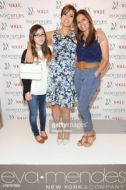 Eva Mendes poses with her sister Janet Mendes and niece as they attend the Eva Mendes For New York Company Spring Launch at the Los Cerritos Center...
