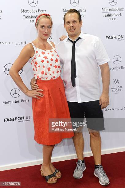 Eva Mona Rodekirchen and Bjoern Geske attend the Lena Hoschek show during the MercedesBenz Fashion Week Berlin Spring/Summer 2016 at Brandenburg Gate...
