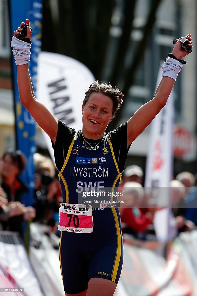 Eva Nystrom (Silver medal) of Sweden celebrates crossing the finish line the Elite Womens Long Distance race during the 2013 Horst ETU Powerman Long Distance and Sprint Duathlon European Championships on April 21, 2013 in Horst, Netherlands.