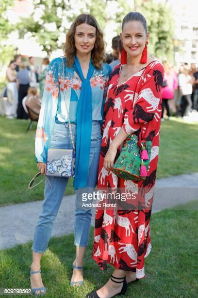 Eva Padberg and designer Nina Kuhn pose at the Rianna Nina Defile during 'Der Berliner Mode Salon' Spring/Summer 2018 at Kronprinzenpalais on July 5...