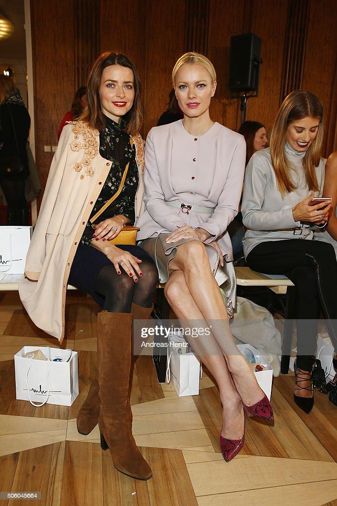 Eva Padberg and Franziska Knuppe attend the Marina Hoermanseder show as part of Der Berliner Mode Salon during the Mercedes-Benz Fashion Week Berlin Autumn/Winter 2016 at Kronprinzenpalais on January 21, 2016 in Berlin, Germany.