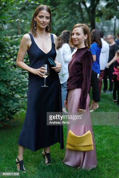 Eva Padberg and Katharina Schuettler pose at the Hugo Boss presentation during 'Der Berliner Mode Salon' Spring/Summer 2018 at St Agnes Church on...