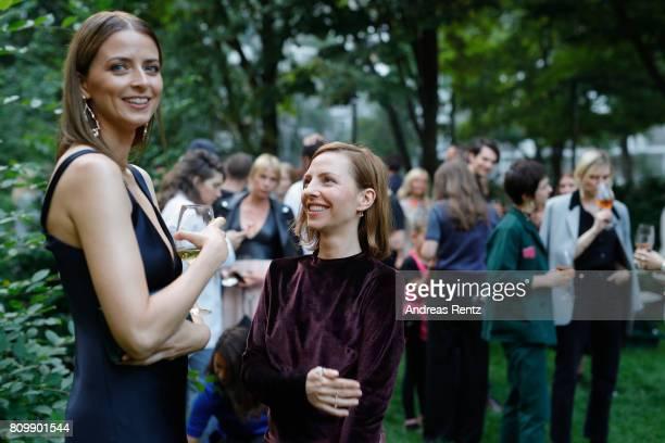 Eva Padberg and Katharina Schuettler pose at the Hugo Boss presentation during 'Der Berliner Mode Salon' Spring/Summer 2018 at St Agnes Church on...