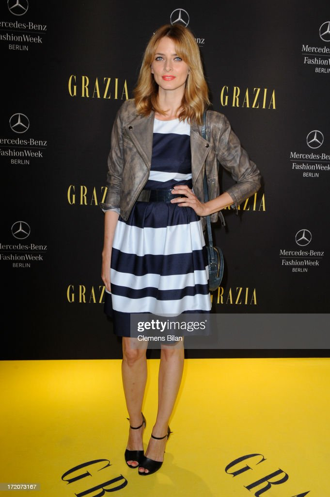Eva Padberg attends the Mercedes-Benz Fashion Week Berlin Spring/Summer 2014 Preview Show by Grazia at the Brandenburg Gate on July 1, 2013 in Berlin, Germany.