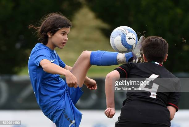 Eva Scnatzer of SSV Brixen obi Women Under 12 competes for the ball with Martina Galati of AC Milan during the match between AC Milan and SSV Brixen...