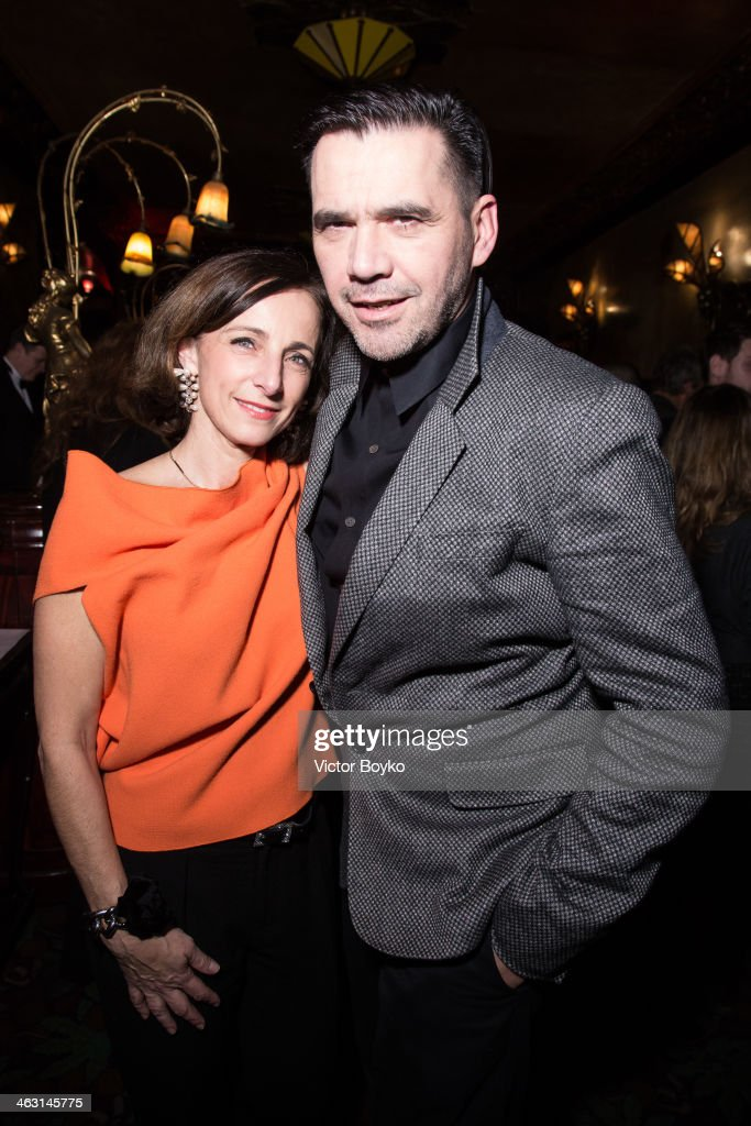 Eva Taub and <a gi-track='captionPersonalityLinkClicked' href=/galleries/search?phrase=Roland+Mouret+-+Fashion+Designer&family=editorial&specificpeople=4863595 ng-click='$event.stopPropagation()'>Roland Mouret</a> attend the celebration launch of first Robert Clergerie Homme Menswear Fall/Winter 2014-2015 collection as part of Paris Fashion Week on January 16, 2014 in Paris, France.