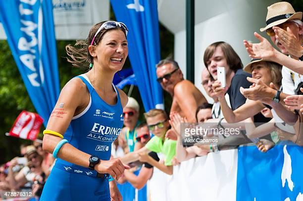 Eva Wutti of Austria celebrates as he arrives in first place to the finish line and wins Ironman Klagenfurt on June 28 2015 in Klagenfurt Austria