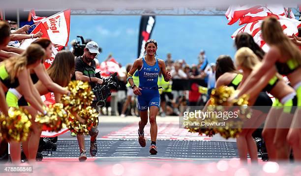 Eva Wutti of Austria celebrates as she wins the womens race during Ironman Klagenfurt on June 28 2015 in Klagenfurt Austria