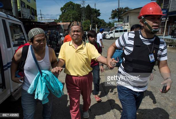 Evacuated residents arrive at a checkpoint in Marawi City on the southern island of Mindanao on June 4 2017 Efforts to rescue up to 2000 civilians...