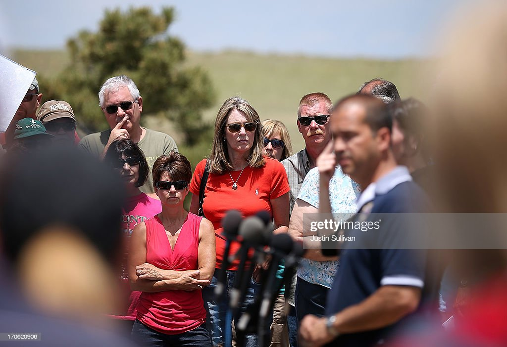 Evacuated residents look on as El Paso County sheriff Terry Maketa speaks to reporters and residents during a press conference on June 15, 2013 in Colorado Springs, Colorado. The Black Forest fire is the most destructive in Colorado history, having consumed more than 15,000 acres as of this morning while destroying 473 homes. The fire is 45 percent contained. Two people have died in the fire.