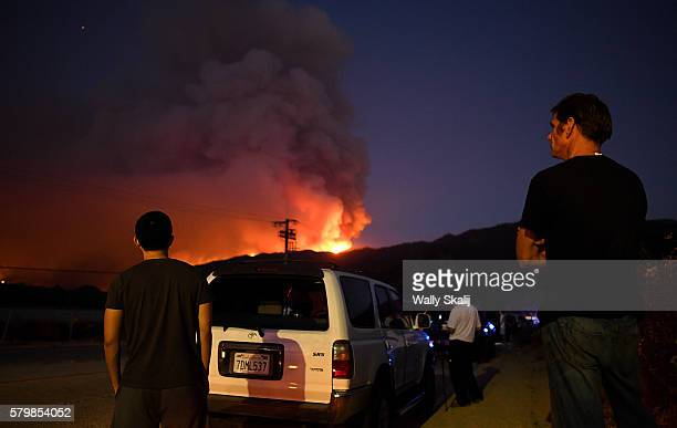 Evacuated residents wait patiently along Placerita Canyon Road as the Sand Fire burns in the San Gabriel Mountains Sunday