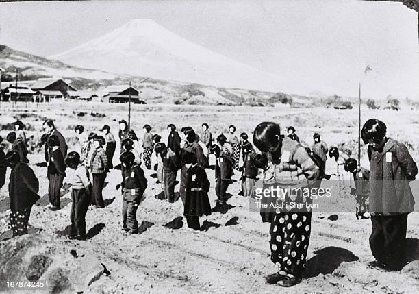 Evacuated school pupils step wheat in April 1945 in Susono Shizuoka Japan Mt Fuji is recommended to be registered as World Heritage site
