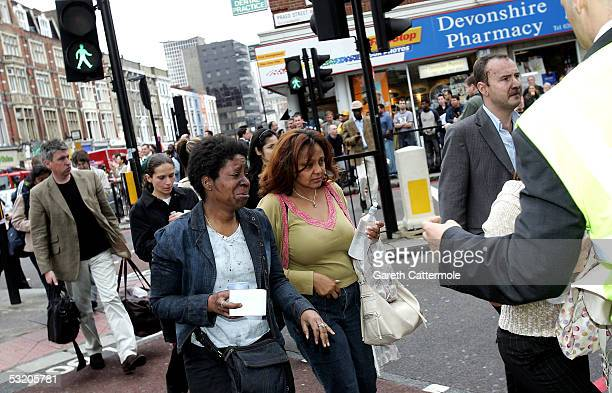 Evacuated tube passengers fill the street at Edgware Road following an explosion which ripped through London's inderground tube network on July 7...