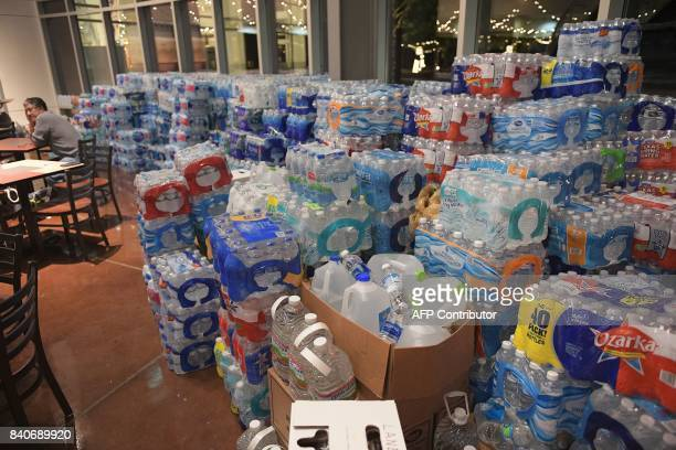 Evacuee Arnulfo Rosales is seated near cases of drinking water at a dining area in Woodlands Church which has been set up as a shelter for those...