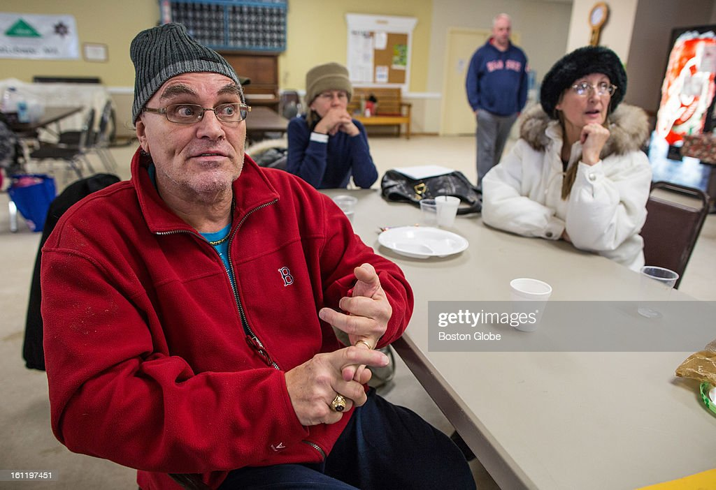 Evacuee Augie Papetti, 69, asked emergency management personal when he might be able to return home while at the William Hilton Senior Center in Salisbury after a large winter storm hit the region and high surf damaged his waterfront home.