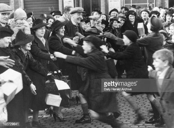 Evacuee children greeting their parents from London 4 December 1939 'Parents of evacuated London children travelled in special trains yesterday for a...