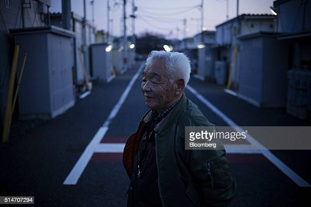 Evacuee Noriaki Yamamoto is photographed at prefabricated temporarily housing complex near an evacuation zone area damaged by the 2011 earthquake and...