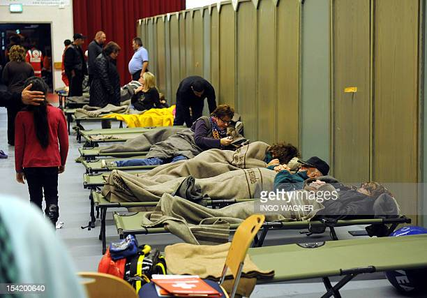 Evacuee sleep at a function room of the factory Kraft Foods after an accident at Kraft Foods in Bad Fallingbostel northern Germany on October 16 2012...