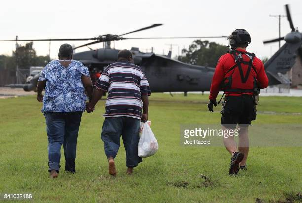 Evacuees are prepared to be airlifted by the Florida Air Force Reserve Pararescue team from the 308th Rescue Squadron after being rescued from the...
