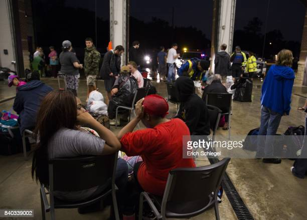 Evacuees from flooded areas find shelter at the Westlake Fire Department after being rescued from high water from Hurricane Harvey August 28 2017 in...