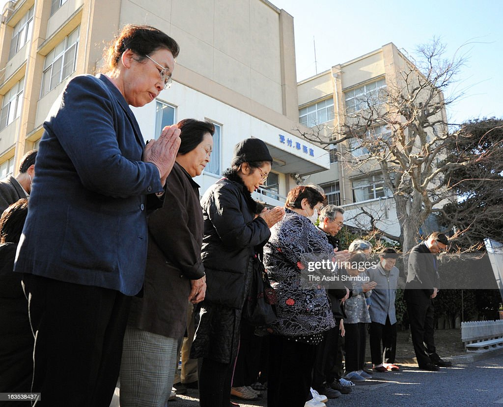 Evacuees from Futaba town, where most of the area are designated as no-go zone, pray in remembrance of the Magnitude 9.0 Earthquake and tsunami victims on March 11, 2013 in Kazo, Saitama, Japan. Japan commemorates second anniversary of the Magnitude 9.0 earthquake and subsequent tsunami, that claimed more than 18,000 lives.