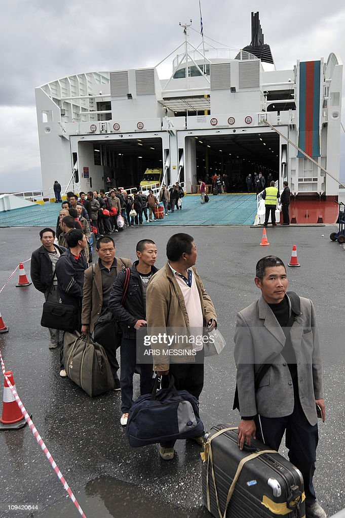 Evacuees from Libya, mostly Chinese, arrive at the port of Herakleion, on Crete island on February 24, 2011. Thousands of Chinese and scores of Europeans began landing Thursday at the port of Heraklion on the Greek island of Crete after their evacuation from unrest-hit Libya aboard chartered Greek ferries. The first boat from the Libyan port of Benghazi, the ferry Hellenic Spirit, reached Heraklion after 1200 GMT and was followed by the ferry Olympic champion, an AFP photographer reported. AFP PHOTO / Aris Messinis