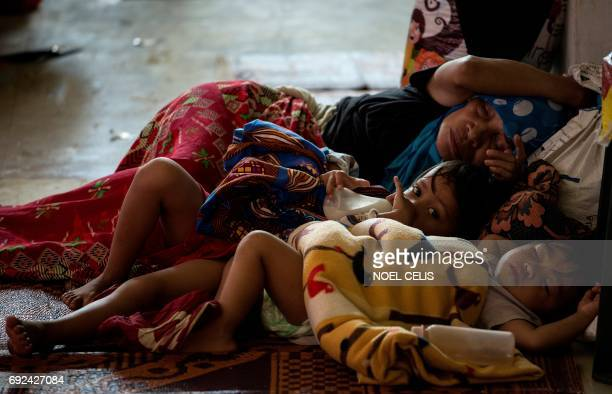 Evacuees from Marawi City camp rest at the Saguiaran Townhall in Lanao del Sur on the southern island of Mindanao on June 5 2017 Efforts to rescue up...