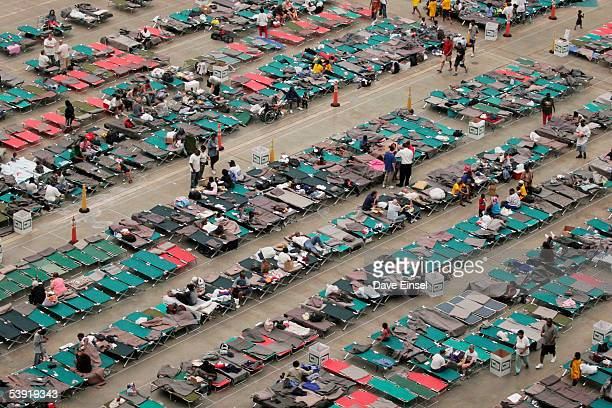Evacuees from the New Orleans area take shelter in the Reliant Astrodome September 1 2005 in Houston Texas Red Cross officials claimed 5000 evacuees...