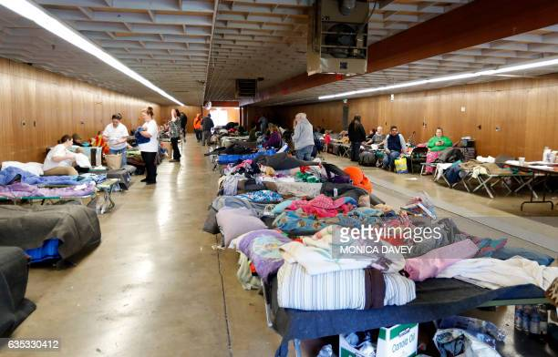 Evacuees from the Oroville Dam area are seen at a temporary shelter in the Silver Dollar Fairgrounds in Chico California on February 14 2017 A...