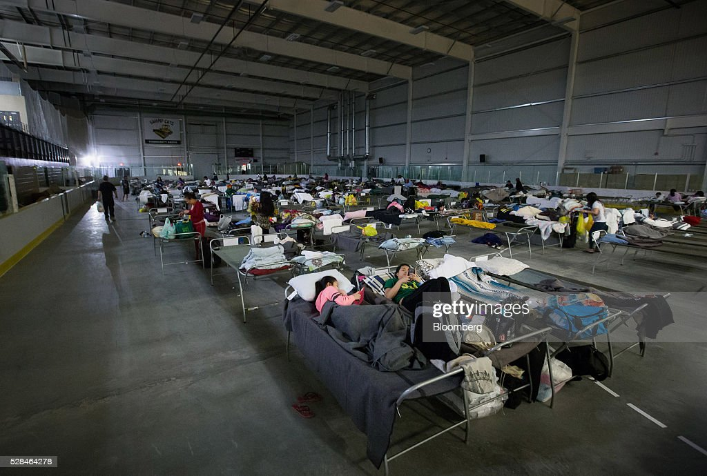 Evacuees from wildfires in the Fort McMurray area lie on cots at a hockey rink in Lac La Biche, Alberta, Canada, on Thursday, May 5, 2016. A fire fueled by shifting winds that forced more than 80,000 people to flee their homes and threatened the business district of oil-sands hub Fort McMurray, Canada, raged out of control Wednesday after consuming 80 square kilometers (30 square miles) of land and damaging 1,600 buildings. Photographer: Darryl Dyck/Bloomberg via Getty Images