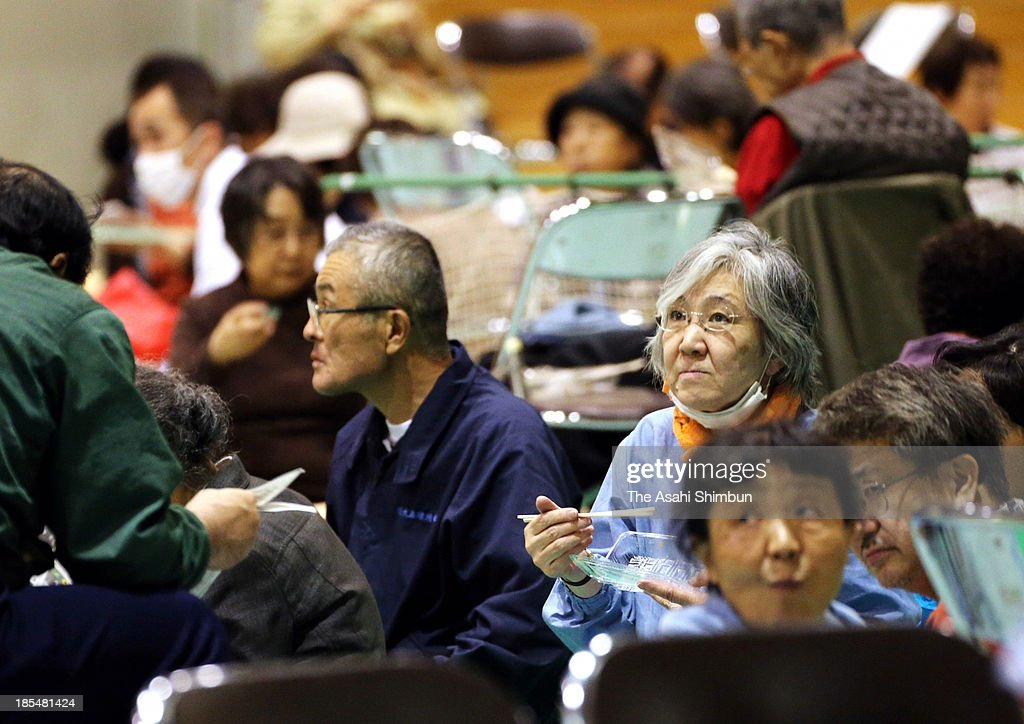Evacuees gather at Oshima Gigh School, where evacuation center is set, on October 19, 2013 in Oshima, Tokyo, Japan. The evacuation advisory was issued as another heavy rain was expected at a landslide devastated Oshima Island. The early morning downpours from Typhoon Wipha, or No. 26 on October 16 caused landslides that covered 1.14 million square meters and damaged or destroyed 283 homes, according to estimates by Oshima town officials.