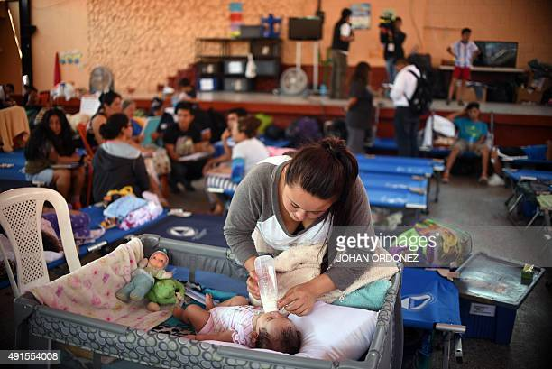 Evacuees remain at a makeshift shelter in Santa Catarina Pinula municipality some 15 km east of Guatemala City on October 6 after Thursday's...