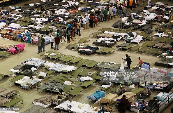 Evacuees take advantage of the shelter setup in the The Baton Rouge River Center arena as the area deals with the record flooding that took place...
