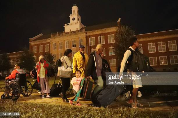 Evacuees wait at Woodrow Wilson Middle School for word about what shelter they will be sent to after they were evacuated from the flooding of...