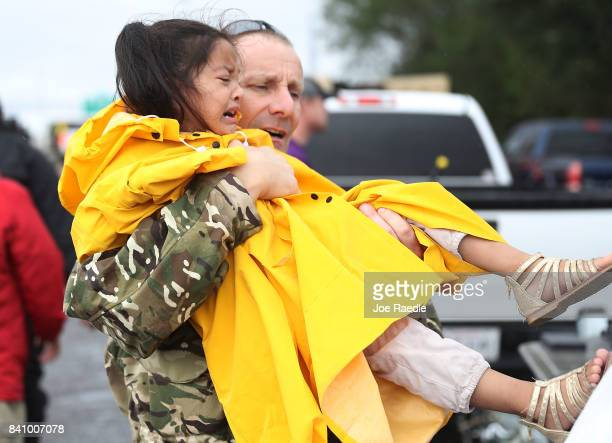 Evacuees wait to be transported to a shelter after being rescued from the flooding of Hurricane Harvey on August 30 2017 in Port Arthur Texas Harvey...