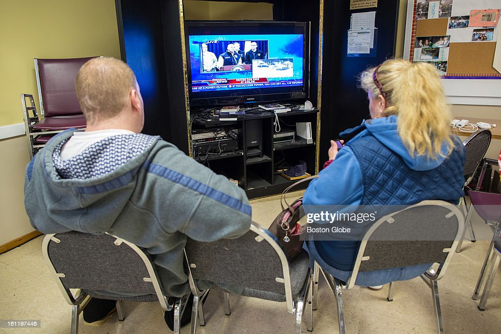 Evacuees watched the Governor's press conference while at the William Hilton Senior Center waiting for word that they could return to their homes in Salisbury after a large winter storm hit the region and high surf threatened their waterfront homes.