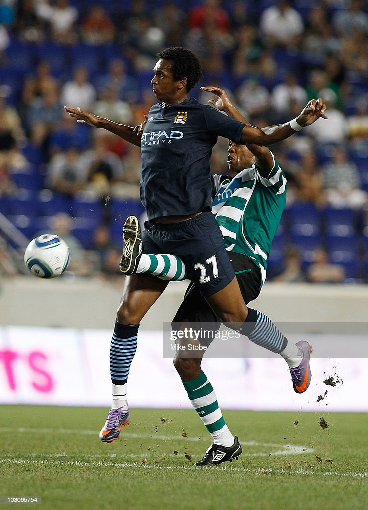Evaldo Fabiano #5 of Sporting Lisbon battles for the ball against <a gi-track='captionPersonalityLinkClicked' href=/galleries/search?phrase=Jo+Silva&family=editorial&specificpeople=5447304 ng-click='$event.stopPropagation()'>Jo Silva</a> #27 of Manchester City on July 23, 2010 at Red Bull Arena in Harrison, New Jersey. Sporting Lisbon won 2-0.